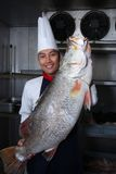 Chef and big fish Stock Photos