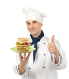 Chef with big sandwich. Chef holding a plate with big sandwich Stock Photo