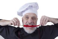Chef biting chili Stock Images