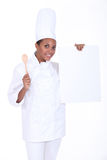 Chef with a blank board Royalty Free Stock Photo
