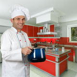 Chef in blue kitchen Stock Photo