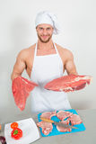 Chef bodybuilder preparing large chunks of raw meat. natural proteins Stock Images