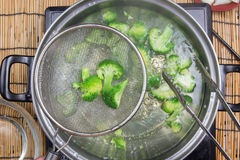 Chef boiling Broccoli in pan Royalty Free Stock Image
