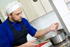 Chef boiling rice Royalty Free Stock Images