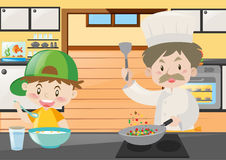 Chef and boy cooking in kitchen Royalty Free Stock Photography