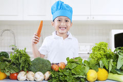 Chef boy is cooking vegetables Stock Image