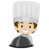 Chef Boy Holding a Food Cloche Royalty Free Stock Image