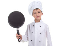 Chef boy holding frying pan isolated on white background.  Royalty Free Stock Image