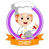 Chef boy holding plate dish Stock Image