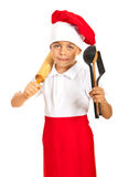 Chef boy holding utensils Royalty Free Stock Image