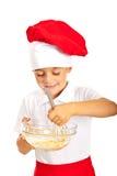 Chef boy mixing dough Royalty Free Stock Photo