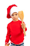 Chef boy showing wooden utensil Royalty Free Stock Photography