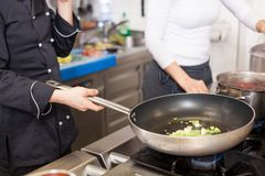 Chef or braising meat in a frying pan Stock Photos