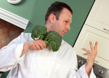 Chef and broccoli Stock Images