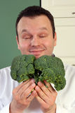 Chef and broccoli Royalty Free Stock Photos