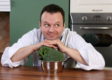 Chef and broccoli Royalty Free Stock Photo