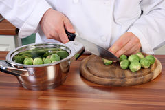 Chef and brussel sprouts Stock Photography