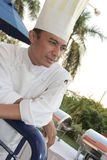Chef at buffet. Chef proud at buffet restaurant Royalty Free Stock Photography