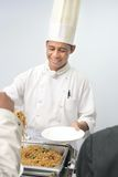 Chef at buffet. Senior chef at buffet smiling Royalty Free Stock Image