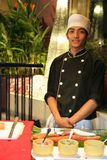 Chef in buffet dinner. Chef smiling and stand by in buffet dinner at sashimi section Royalty Free Stock Photography