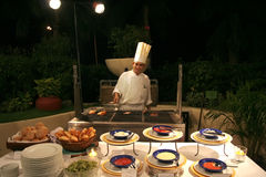 Chef at buffet restaurant. Chef at outdoor buffet restaurant. Chef series here royalty free stock photo