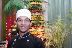 Chef in buffet smiling royalty free stock photo