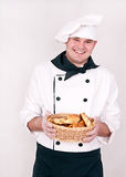 Chef with buns Stock Images
