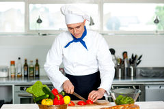 Chef carefully chopping vegetables Royalty Free Stock Photography