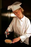 Chef Carmelizing Cream Boule. With torch Royalty Free Stock Photo