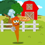 Chef carrot with pizza pointing at viewer on a farm Royalty Free Stock Photo