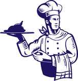 Chef carrying a plate of food Royalty Free Stock Image