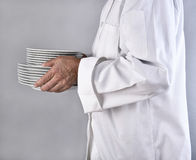 Chef Carrying Plates Royalty Free Stock Images