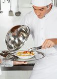 Chef Checking Pasta Dish With Tong Royalty Free Stock Photo