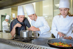 Chef checking work trainee cooks stock images