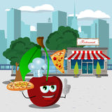 Chef cherry holding pizza with attitude in front of a restaurant Royalty Free Stock Photos