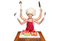 Chef Child with Many Arms. A little girl pretends to have several arms in order to prepare her fruits for a meal Stock Images