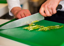 Chef chopping leek and doing preparations Stock Image