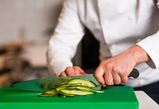 Chef chopping leek, doing preparations Stock Images