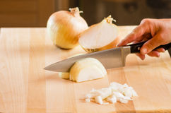 Chef chopping onions on cutting board Stock Photos