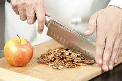 Chef Chopping Pecans. Close-up of a chef chopping pecans Royalty Free Stock Photos