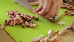 Chef chopping smoked bacon - closeup. HD 1080 static: Chef chopping smoked bacon - closeup stock video footage