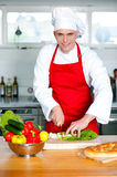 Chef chopping vegetables in kitchen Royalty Free Stock Photography