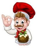 Chef in Christmas Hat Holding Pudding. A chef cartoon character wearing a Santa like hat holding a Christmas pudding and doing a perfect gesture Stock Photos