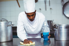 Chef cleaning kitchen counter Royalty Free Stock Images