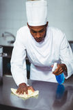 Chef cleaning kitchen counter Stock Photography