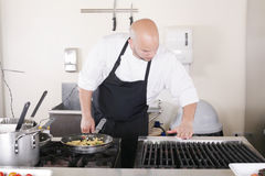 Chef cleaning the kitchen Royalty Free Stock Images
