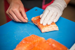 Chef cleaning salmon Stock Photos