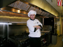 Chef, Cocky. The chef seems quite confident Royalty Free Stock Images