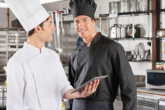 Chef With Colleague Holding Digital Tablet Royalty Free Stock Photos