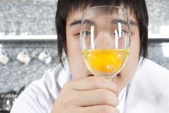 Chef considering a glass of raw egg Royalty Free Stock Images